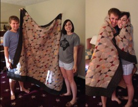 Jordan and I with the quilt my mom made us for our wedding